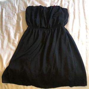 Black strapless dress with red bow